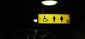 Photo of a yellow restroom sign