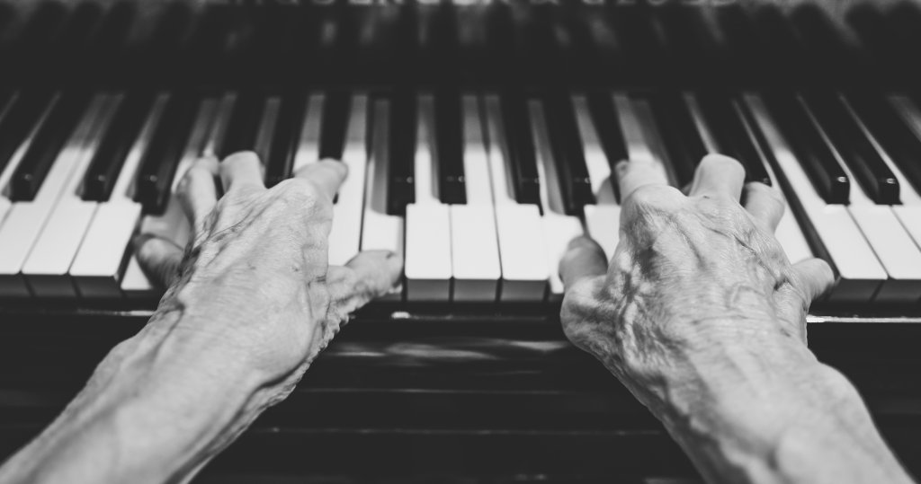 Photograph of man playing the piano
