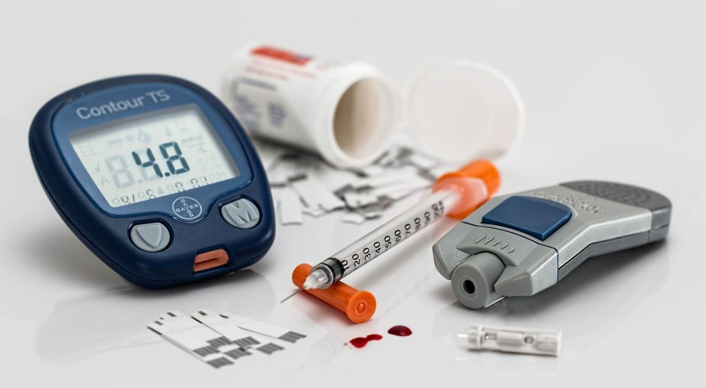 Photo of a blood sugar tester and diabetes medications