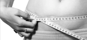 Measuring tape across a stomach